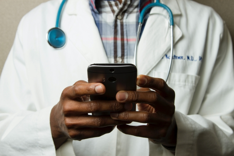 Doctor using a smartphone